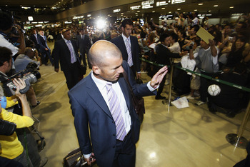 NARITA, JAPAN - JULY 27:  French football player Zinedine Zidane waves to fans as he arrives at New Tokyo International Airport, on July 27, 2004 in Narita, Japan. Real Madrid is in Japan to play friendly games with local teams as part of a pre-season tou