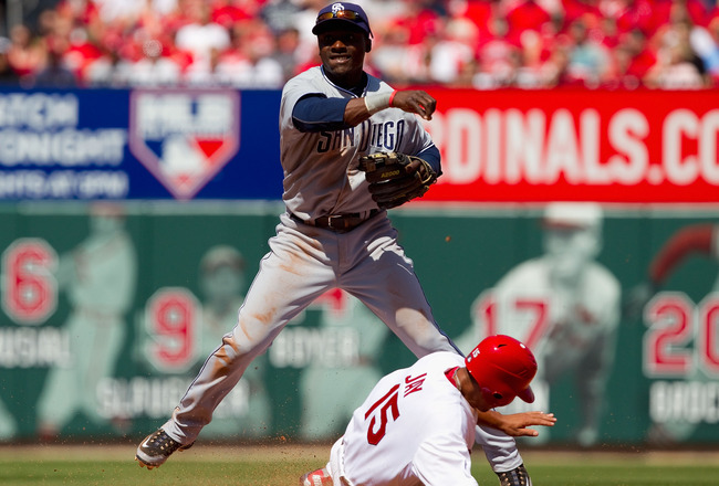 ST. LOUIS, MO - APRIL 3: Orlando Hudson #1 of the San Diego Padres turns a double play over Jon Jay #15 of the St. Louis Cardinals at Busch Stadium on April 3, 2011 in St. Louis, Missouri.  (Photo by Dilip Vishwanat/Getty Images)