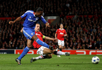 MANCHESTER, ENGLAND - APRIL 12:  Didier Drogba of Chelsea scores his team's first goal during the UEFA Champions League Quarter Final second leg match between Manchester United and Chelsea at Old Trafford on April 12, 2011 in Manchester, England.  (Photo 