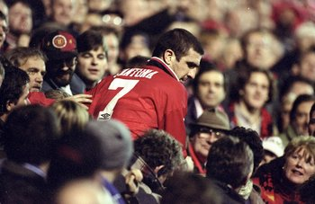 12 Dec 1995:  Eric Cantona of Manchester United is surrounded by the fans after an FA Carling Premiership match against Chelsea at Old Trafford in Manchester, England. The match ended in a 1-1 draw. \ Mandatory Credit: Ross  Kinnaird/Allsport