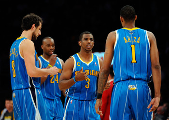 LOS ANGELES, CA - APRIL 20:  (C) Chris Paul #3 of the New Orleans Hornets talks with teammates Marco Belinelli #8 and Trevor Ariza #1 while taking on the Los Angeles Lakers in Game Two of the Western Conference Quarterfinals in the 2011 NBA Playoffs on Ap