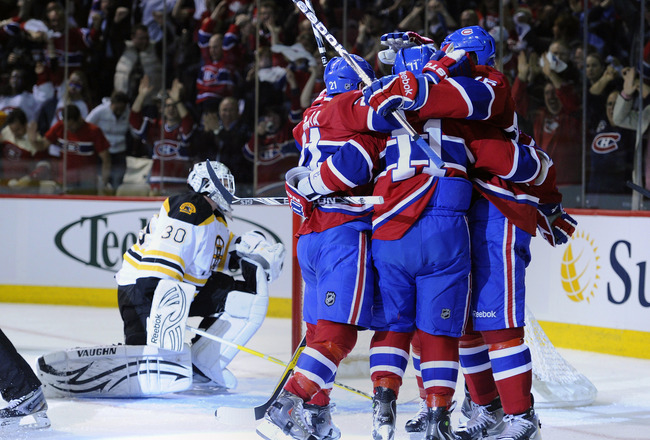 MONTREAL, QC - APRIL 21:  Tim Thomas #30 of the Boston Bruins looks into his net dejectedly while Brian Gionta #21;Scott Gomez #11 and P.K. Subban #76 of the Montreal Canadiens celebrate a goal in Game Four of the Eastern Conference Quarterfinals during t