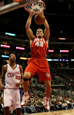 LOS ANGELES - JANUARY 18:   Chris Humphries #43 of the New Jersey Nets dunks over Marcus Camby #23 of the Los Angeles Clippers on January 18, 2010 at Staples Center in Los Angeles, California. The Clippers won 106-95.  NOTE TO USER: User expressly acknowl