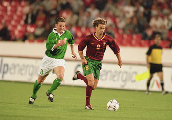 7 Oct 2000:  Joao Pinto of Portugal breezes past Mark Kinsella of Republic of Ireland during the World Cup 2002 Group 2 Qualifying match played at the Stadium of Light, in Lisbon, Portugal. The match ended in a 1-1 draw. \ Photo taken by Nuno Correia \ Ma