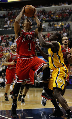 INDIANAPOLIS, IN - APRIL 23: Derrick Rose #1 of the Chicago Bulls puts up a shot against Darren Collison #2 of the Indiana Pacers in Game Four of the Eastern Conference Quarterfinals in the 2011 NBA Playoffs at Conseco Fieldhouse on April 23, 2011 in Indi