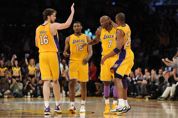 LOS ANGELES, CA - APRIL 20:  (L-R) Pau Gasol #16, Ron Artest #15, Lamar Odom #7 and Kobe Bryant #24 of the Los Angeles Lakers celebrate while taking on the New Orleans Hornets in Game Two of the Western Conference Quarterfinals in the 2011 NBA Playoffs on
