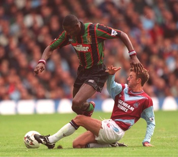 17 SEP1994:  JOHN FASHANU OF WIMBLEDON IS TACKLED BY KEITH ROWLAND OF WEST HAM DURING THEIR ENGLISH FA PREMIERSHIP MATCH AGAINST ASTON VILLA AT UPTON PARK IN LONDON. Mandatory Credit: Mike Hewitt/ALLSPORT
