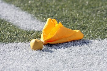 SEATTLE - SEPTEMBER 23:  A penalty flag lies on the field during the Seattle Seahawks game against the Cincinnati Bengals at Qwest Field on September 23, 2007 in Seattle, Washington. The Seahawks won 24-21. (Photo by Otto Greule Jr/Getty Images)