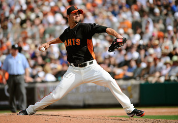 SCOTTSDALE, AZ - MARCH 18:  Ryan Vogelsong #32 of the San Francisco Giants pitches during the spring training baseball game against the Los Angeles Dodgers at Scottsdale Stadium on March 18, 2011 in Scottsdale, Arizona.  (Photo by Kevork Djansezian/Getty