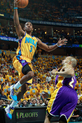NEW ORLEANS, LA - APRIL 22:  Chris Paul #3 of the New Orleans Hornets shoots the ball over Derek Fisher #2  of the Los Angeles Lakers in Game Three of the Western Conference Quarterfinals in the 2011 NBA Playoffs at the New Orleans Arena  on April 22, 201