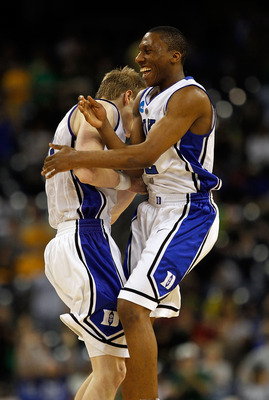 HOUSTON - MARCH 28: Nolan Smith #2 (R) and Kyle Singler #12 of the Duke Dlue Devils celebrate a win over the Baylor Bears during the south regional final of the 2010 NCAA men's basketball tournament at Reliant Stadium on March 28, 2010 in Houston, Texas.