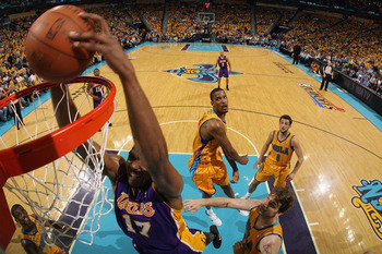 NEW ORLEANS, LA - APRIL 22:  Andrew Bynum #17 of the Los Angeles Lakers dunks the ball during the game against the New Orleans Hornets in Game Three of the Western Conference Quarterfinals in the 2011 NBA Playoffs at the New Orleans Arena  on April 22, 20