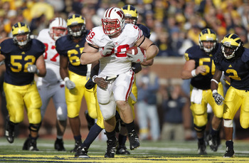 ANN ARBOR, MI - NOVEMBER 20:  J.J. Watt #99 of the Wisconsin Badgers tries to outrun the Michigan offense after intercepting a fourth quarter pass while playing the Michigan Wolverines at Michigan Stadium on November 20, 2010 in Ann Arbor, Michigan. Wisco