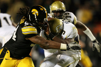 MIAMI GARDENS, FL - JANUARY 05:  Josh Nesbitt #9 of the Georgia Tech Yellow Jackets is bought down by Adrian CLayborn #94 of the Iowa Hawkeyes during the FedEx Orange Bowl at Land Shark Stadium on January 5, 2010 in Miami Gardens, Florida.  (Photo by Doug
