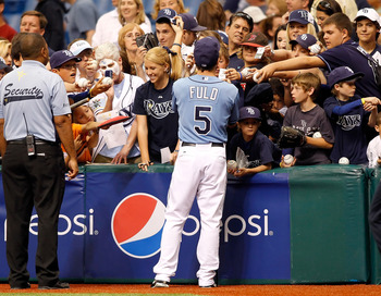ST. PETERSBURG, FL - APRIL 17:  Outfielder Sam Fuld #5 of the Tampa Bay Rays signs some autographs just before the start of the game against the Minnesota Twins at Tropicana Field on April 17, 2011 in St. Petersburg, Florida.  (Photo by J. Meric/Getty Ima