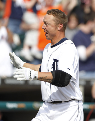 DETROIT - APRIL 13:  Brandon Inge #15 of the Detroit Tigers celebrates after hitting a walk off home in the ninth inning during the game against the Texas Rangers at Comerica Park on April 13, 2011 in Detroit, Michigan. The Tigers defeated the Rangers 3-2