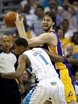 NEW ORLEANS - APRIL 24:  Trevor Ariza #1 of the New Orleans Hornets guards Pau Gasol #16 of the Los Angeles Lakers in Game Four of the Western Conference Quarterfinals in the 2011 NBA Playoffs at New Orleans Arena on April 24, 2011 in New Orleans, Louisia