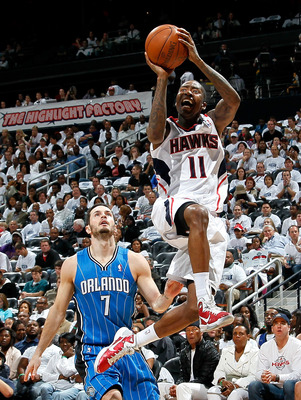ATLANTA, GA - APRIL 22:  Jamal Crawford #11 of the Atlanta Hawks shoots against J.J. Redick #7 of the Orlando Magic during Game Three of the Eastern Conference Quarterfinals in the 2011 NBA Playoffs at Philips Arena on April 22, 2011 in Atlanta, Georgia.