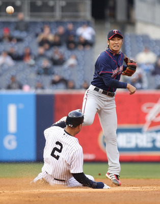 NEW YORK, NY - APRIL 07:  Tsuyoshi Nishioka #1 of the Minnesota Twins fails to turn the double play over Derek Jeter #2 of the New York Yankees at Yankee Stadium on April 7, 2011 in the Bronx borough of New York City.  (Photo by Nick Laham/Getty Images)