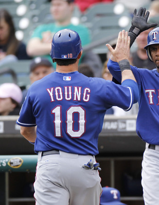 DETROIT, MI - APRIL 11:  Michael Young #10 of the Texas Rangers celebrates scoring a run in the seventh inning with Julio Borbon #20 while playing the Detroit Tigers at Comerica Park on April 11, 2011 in Detroit, Michigan. Texas won the game 2-0. (Photo b