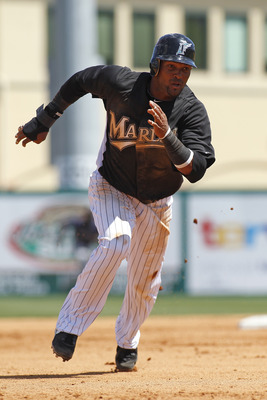 JUPITER, FL - MARCH 24: Emilio Bonifacio #1 of the Florida Marlins scores from second base against the Boston Red Sox at Roger Dean Stadium on March 24, 2011 in Jupiter, Florida. The Marlins defeated the Red Sox 15-7. (Photo by Joel Auerbach/Getty Images)