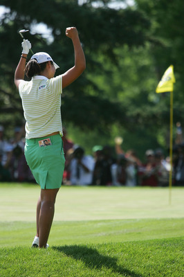 CHERRY HILLS VILLAGE, CO - JUNE 26:  Birdie Kim of Korea celebrates after sinking a birdie shot out of the eighteenth hole bunker to win the 60th U.S. Women's Open Championship at Cherry Hills Country Club on June 26, 2005 in Cherry Hills Village, Colorad