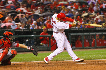 ST. LOUIS, MO - APRIL 24: Yadier Molina #4 of the St. Louis Cardinals hits a three-run home run against the Cincinnati Reds at Busch Stadium on April 24, 2011 in St. Louis, Missouri.  (Photo by Dilip Vishwanat/Getty Images)
