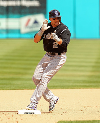 MIAMI GARDENS, FL - APRIL 24:  Troy Tulowitzki #2 of the Colorado Rockies reacts after hitting a 2 RBI double during a game against the Florida Marlins  at Sun Life Stadium on April 24, 2011 in Miami Gardens, Florida.  (Photo by Mike Ehrmann/Getty Images)