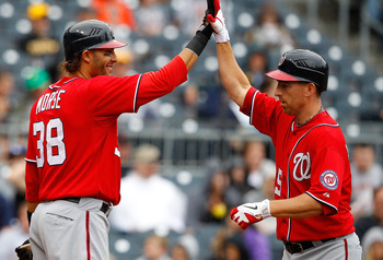 PITTSBURGH - APRIL 24:  Adam LaRoche #25 of the Washington Nationals is congratulated by teammate Michael Morse #38 after scoring a run against  the Pittsburgh Pirates during the game on April 24, 2011 at PNC Park in Pittsburgh, Pennsylvania.  (Photo by J