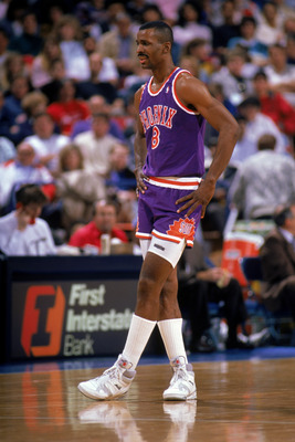 PHOENIX - 1989:  Eddie Johnson #8 of the Phoenix Suns looks on during a 1989 season NBA game at Veteran's Memorial Coliseum in Phoenix, Arizona.  (Photo by Otto Greule Jr./Getty Images)