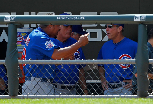 CHICAGO - JUNE 25: Starting pitcher Carlos Zambrano #38 of the Chicago Cubs (L) yells at manager Lou Pinella #41 (center) and bench coach Alan Trammell #3 after giving up four runs in the 1st inning to the Chicago White Sox at U.S. Cellular Field on June