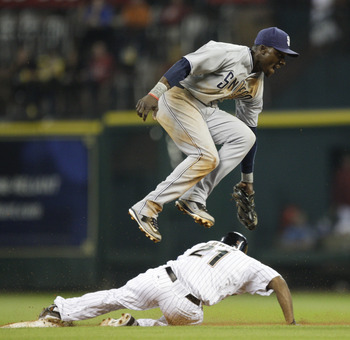 HOUSTON - APRIL 14:  Michael Bourn #21 of the Houston Astros slides underneath second baseman Orlando Hudson #1 as he attempts the tag at Minute Maid Park on April 14, 2011 in Houston, Texas.  (Photo by Bob Levey/Getty Images)