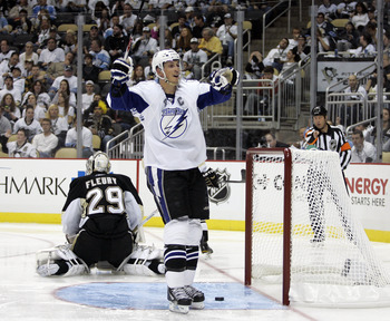 PITTSBURGH, PA - APRIL 23:  Vincent Lecavalier #4 of the Tampa Bay Lightning celebrates his second period goal against the Pittsburgh Penguins in Game Five of the Eastern Conference Quarterfinals during the 2011 NHL Stanley Cup Playoffs at Consol Energy C
