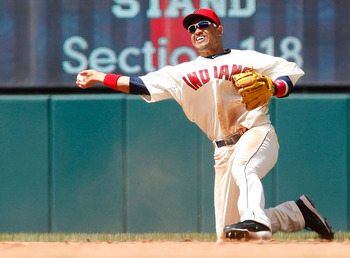 CLEVELAND - APRIL 17:  Orlando Cabrera #20 of the Cleveland Indians fields a ground ball against the Baltimore Orioles during the game on April 17, 2011 at Progressive Field in Cleveland, Ohio.  (Photo by Jared Wickerham/Getty Images)