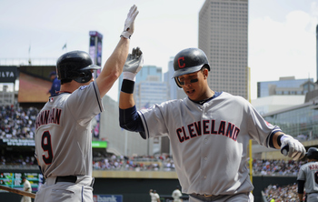 MINNEAPOLIS, MN - APRIL 24: Jack Hannahan #9 and Michael Brantley #23 of the Cleveland Indians celebrate what was thought to be a three-run home run by Brantley against the Cleveland Indians during the third inning of their game on April 24, 2011 at Targe