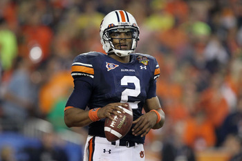 GLENDALE, AZ - JANUARY 10:  Cameron Newton #2 of the Auburn Tigers looks on against the Oregon Ducks during the Tostitos BCS National Championship Game at University of Phoenix Stadium on January 10, 2011 in Glendale, Arizona.  (Photo by Ronald Martinez/G
