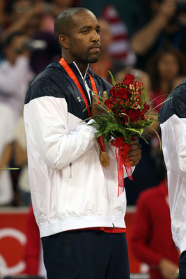 BEIJING - AUGUST 24:  Michael Redd #8 of the United States stands on the podium after winning the gold medal over Spain in the men's basketball final during Day 16 of the Beijing 2008 Olympic Games at the Beijing Olympic Basketball Gymnasium on August 24,