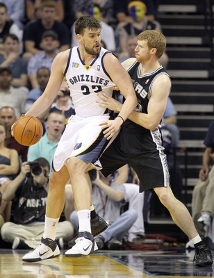 MEMPHIS, TN - APRIL 23:  Marc Gasol #33 of the  Memphis Grizzles dribbles the ball while defended by Matt Bonner #15 of the San Antonio Spurs in Game three of the Western Conference Quarterfinals in the 2011 NBA Playoffs at FedExForum on April 23, 2011 in