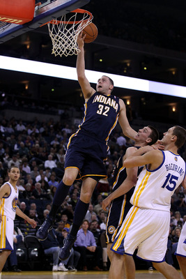 OAKLAND, CA - JANUARY 19: Josh McRoberts #32 of the Indiana Pacers goes up for a shot against the Golden State Warriors at Oracle Arena on January 19, 2011 in Oakland, California.  NOTE TO USER: User expressly acknowledges and agrees that, by downloading