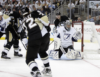 PITTSBURGH, PA - APRIL 13: Dwayne Roloson #35 of the Tampa Bay Lightning makes a glove save on Alexei Kovalev #72 of the Pittsburgh Penguins in Game One of the Eastern Conference Quarterfinals during the 2011 NHL Stanley Cup Playoffs at Consol Energy Cent