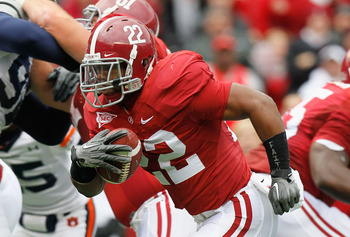 TUSCALOOSA, AL - NOVEMBER 26:  Mark Ingram #22 of the Alabama Crimson Tide rushes for a touchdown against the Auburn Tigers at Bryant-Denny Stadium on November 26, 2010 in Tuscaloosa, Alabama.  (Photo by Kevin C. Cox/Getty Images)