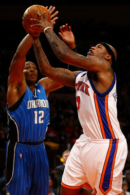 NEW YORK - NOVEMBER 29: Al Harrington #7 of the New York Knicks shoots over Dwight Howard #12 of the Orlando Magic at Madison Square Garden November 29, 2009 in New York City. NOTE TO USER: User expressly acknowledges and agrees that, by downloading and/o