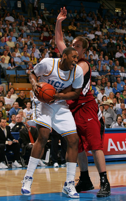 WESTWOOD, CA - JANUARY 31:  J'mison Morgan #22 of the UCLA Bruins posts up Will Paul #34 of Stanford Cardinal int he second half during their NCAA basketball game at Pauley Pavilion on January 31, 2009 in Westwood, California.  The Bruins defeated the Car