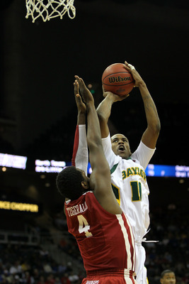 KANSAS CITY, MO - MARCH 09:  J'mison Morgan #11 of the Baylor Bears takes a shot against the Oklahoma Sooners during their game in the first round of the 2011 Phillips 66 Big 12 Men's Basketball Tournament at Sprint Center on March 9, 2011 in Kansas City,