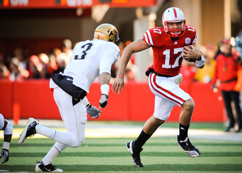LINCOLN, NE - NOVEMBER 26: Cody Green #17 of the Nebraska Cornhuskers slips past Jimmy Smith #3 of the Colorado Buffaloes during their game at Memorial Stadium on November 26, 2010 in Lincoln, Nebraska. Nebraska defeated Colorado 45-17 (Photo by Eric Fran