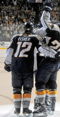 NASHVILLE, TN - APRIL 24:   Mike Fisher #12 and Joel Ward #29 of the Nashville Predators celebrate an open net goal, sealing a victry over the Anaheim Ducks in Game Six of the Western Conference Quarterfinals during the 2011 NHL Stanley Cup Playoffs at Br