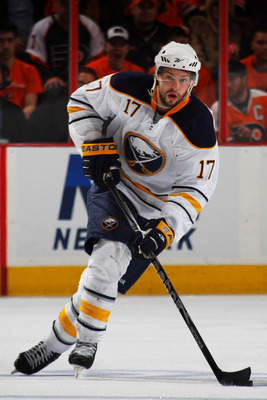 PHILADELPHIA, PA - APRIL 22:  Marc-Andre Gragnani #17 of the Buffalo Sabres controls the puck against the Philadelphia Flyers in Game Five of the Eastern Conference Quarterfinals during the 2011 NHL Stanley Cup Playoffs at Wells Fargo Center on April 22,