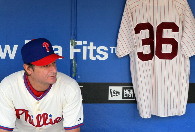 PHILADELPHIA - MAY 06:  Jamie Moyer #50 of the Philadelphia Phillies sits in the dugout next to a jersey of Phillies Hall of Fame pitcher Robin Roberts prior to playing the St. Louis Cardinals at Citizens Bank Park on May 6, 2010 in Philadelphia, Pennsylv