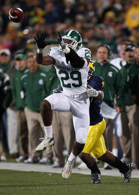 ANN ARBOR, MI - OCTOBER 25: Chris L. Rucker of the Michigan State Spartans intercepts a fourth quarter pass in front of Toney Clemons #17 of the Michigan Wolverines on October 25, 2008 at Michigan Stadium in Ann Arbor, Michigan.  Michigan State won the ga