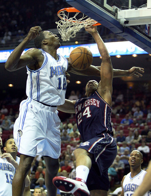 ORLANDO, FL - FEBRUARY 06:  Richard Jefferson #24 of the New Jersey Nets is fouled as he dunks on Dwight Howard #12 of the Orlando Magic at Amway Arena on February 6, 2008 in Orlando, Florida. NOTE TO USER: User expressly acknowledges and agrees that, by
